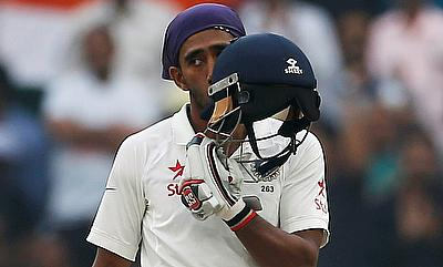 Wridhhiman Saha celebrating his century on day four of Ranchi Test