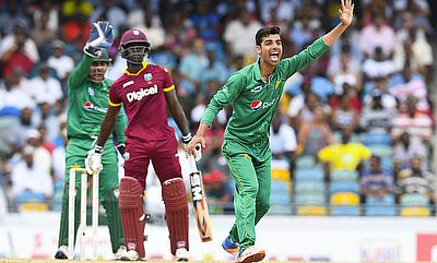 Shadab Khan (right) registered figures of seven for three on his debut