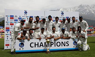Indian team posing with the Border-Gavaskar Trophy