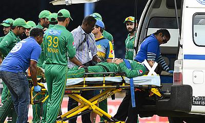 Ahmed Shehzad carried off the field after a collision