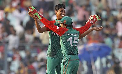 Mustafizur Rahman (left) picked four wickets for Bangladesh