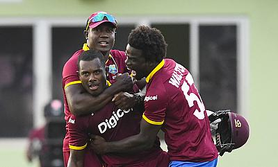 Jason Mohammed (centre) congratulated by his team-mates after the historic win in Guyana