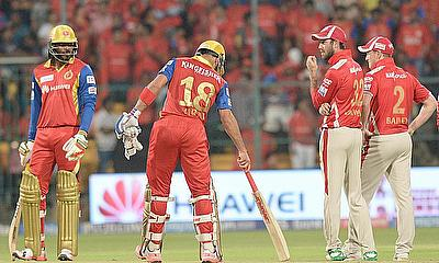 Chris Gayle (left) and Virat Kohli (centre) were instrumental in victory
