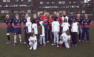 England players during the launch with children from a local primary school