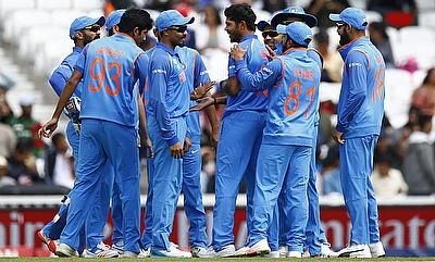 Indian players celebrating the wicket of Imrul Kayes