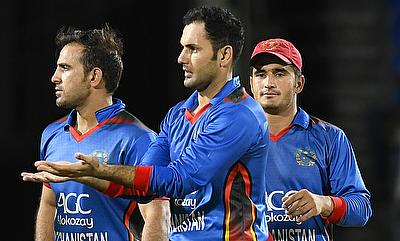 Mohammad Nabi (centre) celebrating a wicket