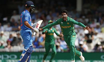 Virat Kohli (left) looks dejected after being dismissed by Mohammad Amir in the final