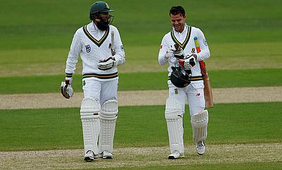 Hashim Amla (left) and Heino Kuhn walking off due to bad light