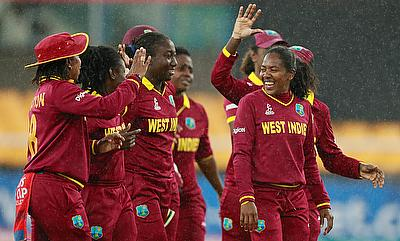 The West Indies players celebrate the wicket of Pakistan's Iram Javed as rain delays play
