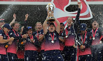 England's players celebrate winning the world cup by lifting the trophy