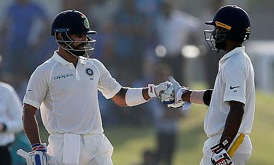 Virat Kohli (left) and Abhinav Mukund in action on day three