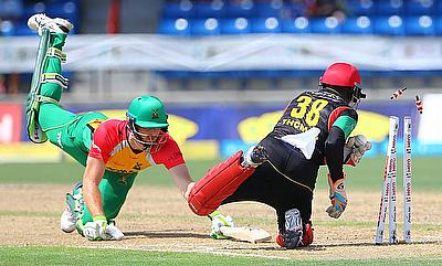 Martin Guptill (left) tries to reach the ground during the game