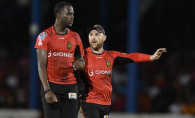 Kevon Cooper (left) picked four wickets in the game