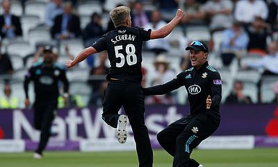 Sam Curran (centre) picked four wickets for Surrey
