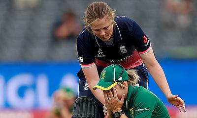 South Africa's Dane Van Niekerk is consoled by England's Anya Shrubsole