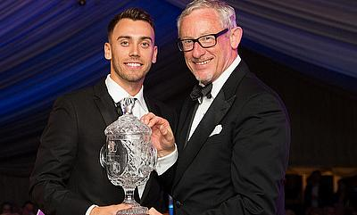 Alex Hughes (left) being awarded the Player of the Year title