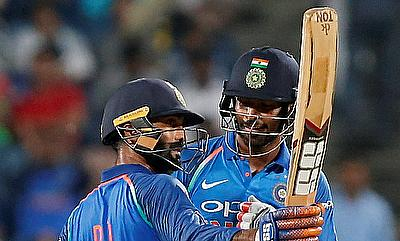 Dinesh Karthik (left) celebrating his half-century in the second ODI in Pune