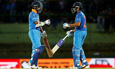 Shikhar Dhawan (left) and Rohit Sharma (right) scored 80 runs each