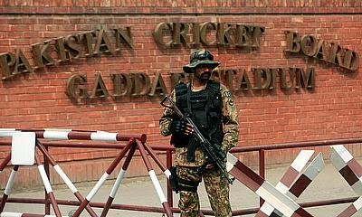 A Pakistani soldier stands guard outside the Gaddafi Cricket Stadium ahead of a Twenty20 international cricket match between Pakistan and Sri Lanka in