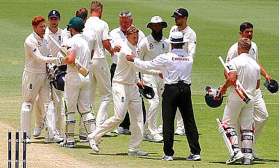 England's Jonny Bairstow shakes hands with Australia's Cameron Bancroft as the teams walk off the ground at the end of the first Test