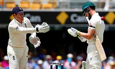 England's wicketkeeper Jonny Bairstow throws the ball past Australia's Cameron Bancroft during the fifth day