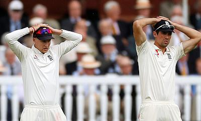 Joe Root (left) has backed Alastair Cook to come good