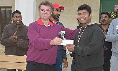 Malta Cricket Chairman Paul Bradley presents the League's Batting Award to Basil George