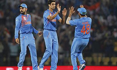 Suresh Raina celebrates with his teammates