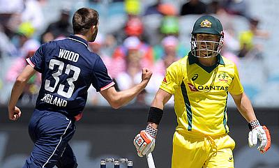 David Warner (right) scored just 12 runs in the three games of Tri-Series