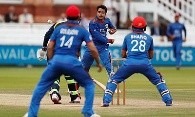 Rashid Khan (centre) picked a five-wicket haul