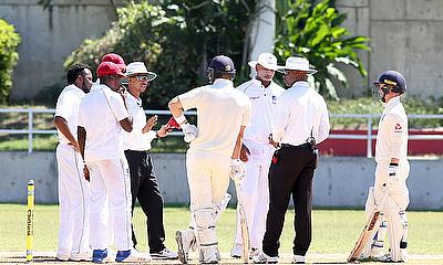 Umpires and players in discussion