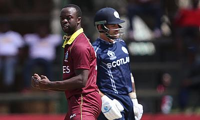 Kemar Roach (left) celebrating the wicket of Kyle Coetzer