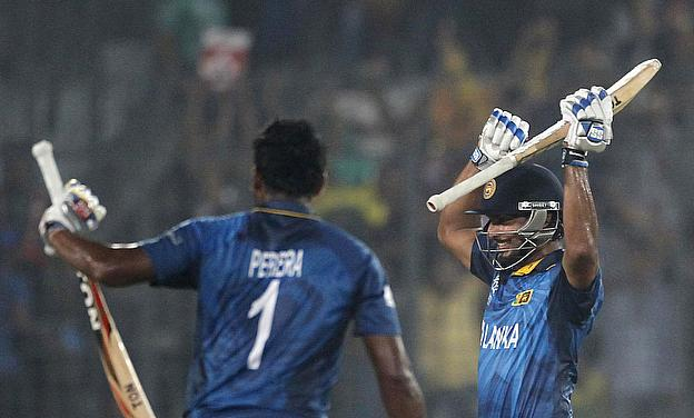Kumar Sangakkara (right) and Thisara Perera celebrate the winning moment of the ICC WT20 2014 final