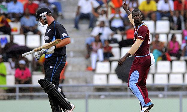 Darren Sammy celebrates as Corey Anderson is dismissed