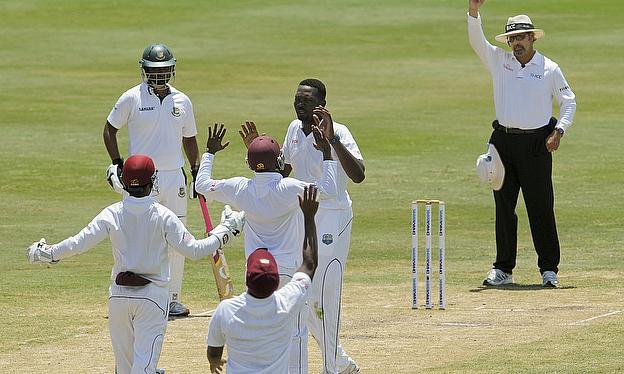 Sulieman Benn celebrates the wicket of Anamul Haque