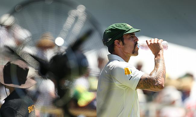 Mitchell Johnson takes a drink