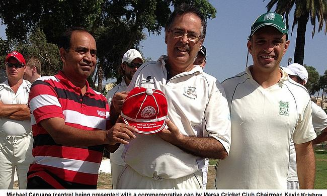 Mike Caruana is presented with a cap