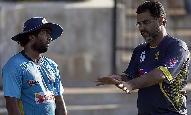 Lasith Malinga (left) and Waqar Younis - two fine fast bowlers from different generations