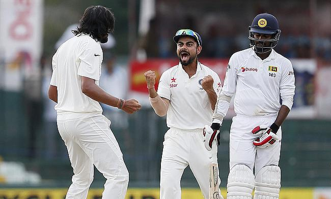 Ishant Sharma (left) and Virat Kohli (centre) reacts after dismissing Upul Tharanga (right) on day four of the third Test in Colombo.