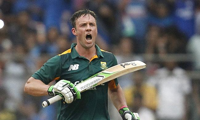 AB de Villiers celebrating his century in the fifth ODI against India in Mumbai.