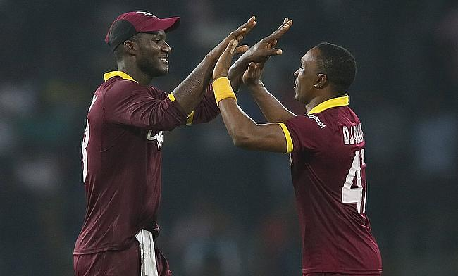 Darren Sammy (left) celebrating with Dwayne Bravo (right) the West Indies win over Sri Lanka in the second T20I in Colombo.