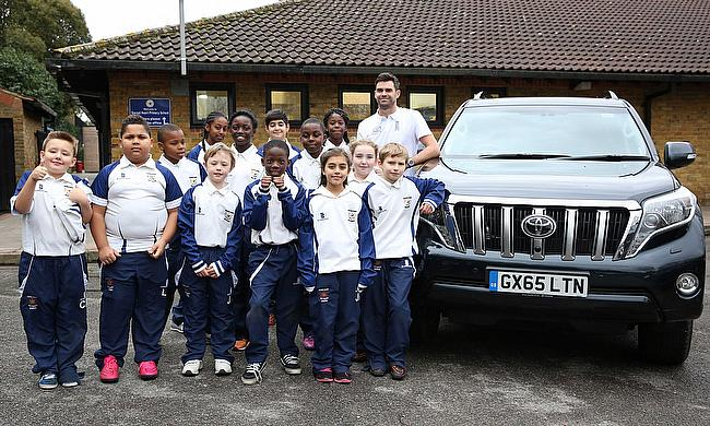 James Anderson pictured with the students at the Sacred Heart School in Battersea