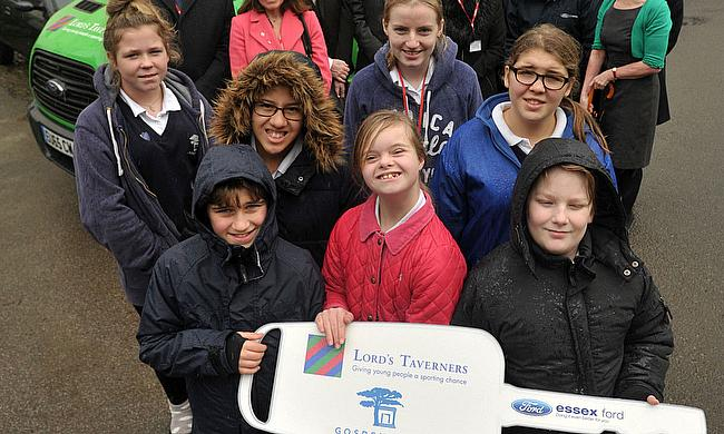 Pupils at Gosden House School are handed the key to their new accessible Lord's Taverners minibus