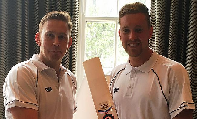 Jake Ball gets his new GM Mana bat in the England hotel from Gunn & Moore executive Richard Harris