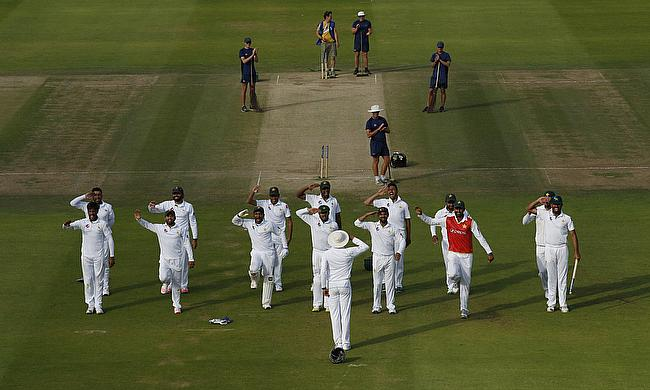 Pakistan celebrate their victory in the first Test over England at Lord's