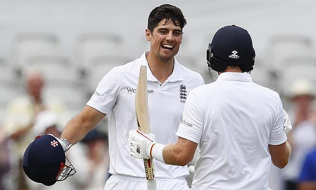 Alastair Cook (left) celebrating his century on day one of the second Test.