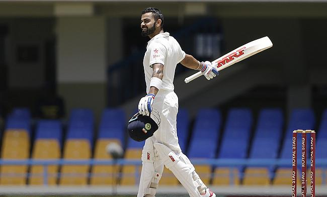 Virat Kohli celebrating his maiden double century.