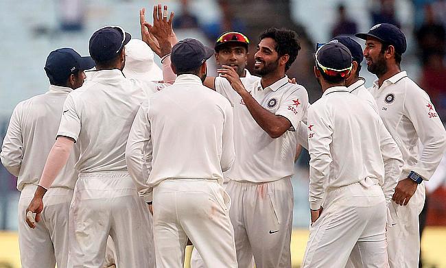 Bhuvneshwar Kumar celebrating the wicket of New Zealand's Matt Henry on day two of second Test