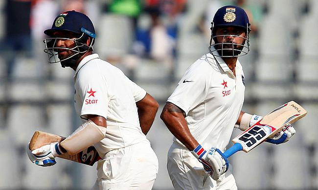Cheteshwar Pujara (left) and Murali Vijay (right) shared an unbeaten 107-run stand for the second wicket