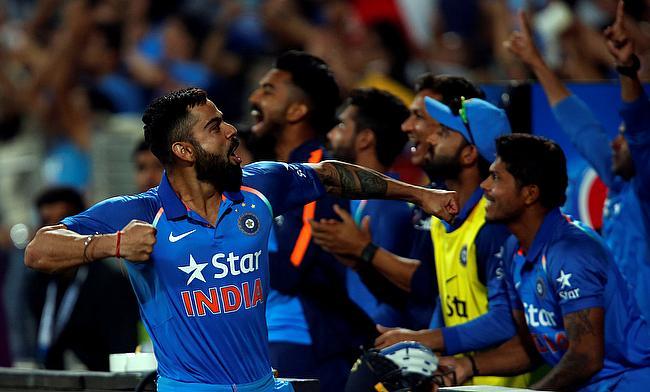 Virat Kohli celebrating the win with fans